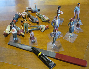 Inexpensive plastic figures ordered in bulk from China, being glued to scrounged PETE bases.  Click for bigger photo.